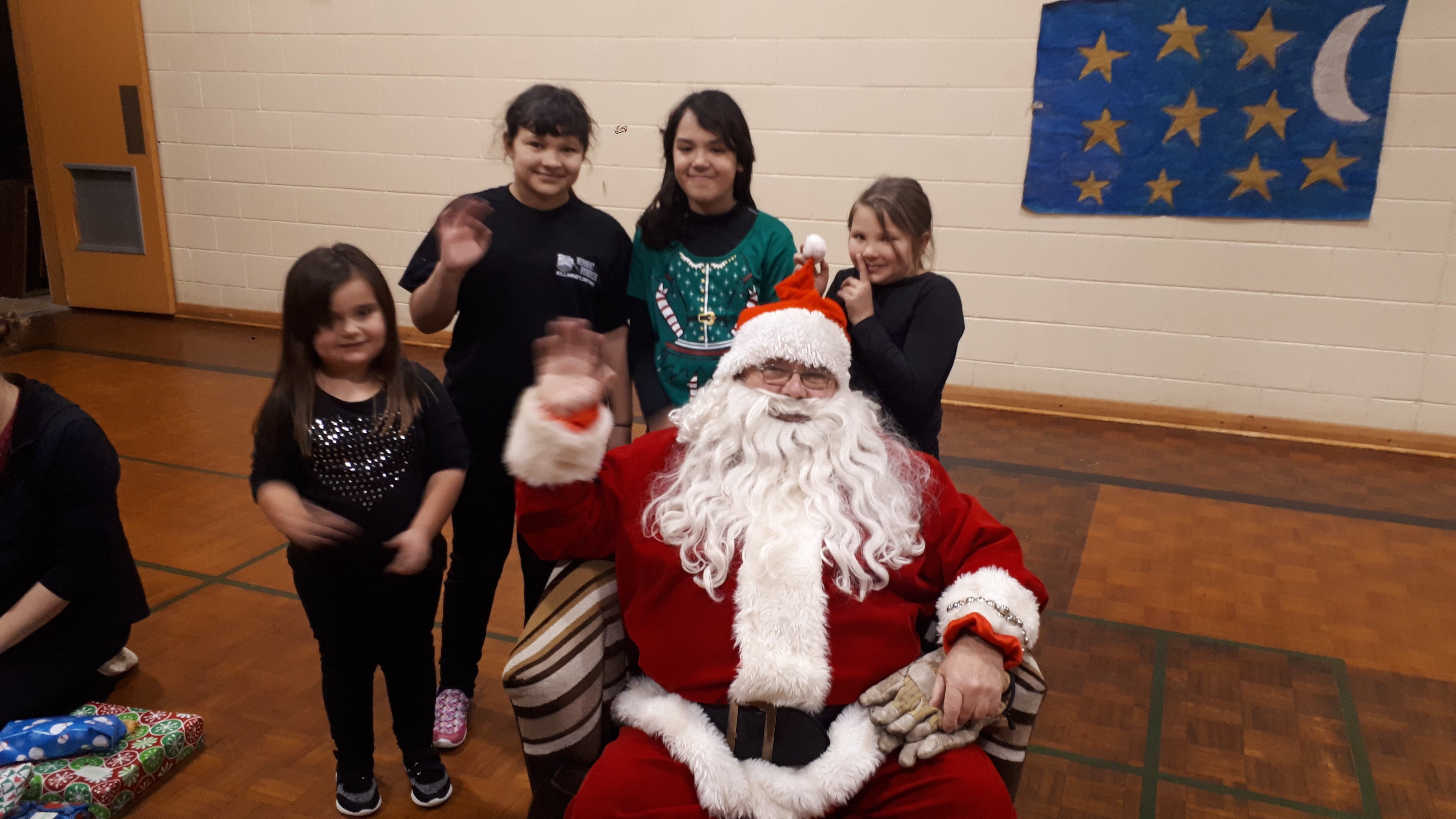 Students Jessica Pawson, Abby Beaucage, Channel Burant-Roque and Emily Beaucage pose with Santa