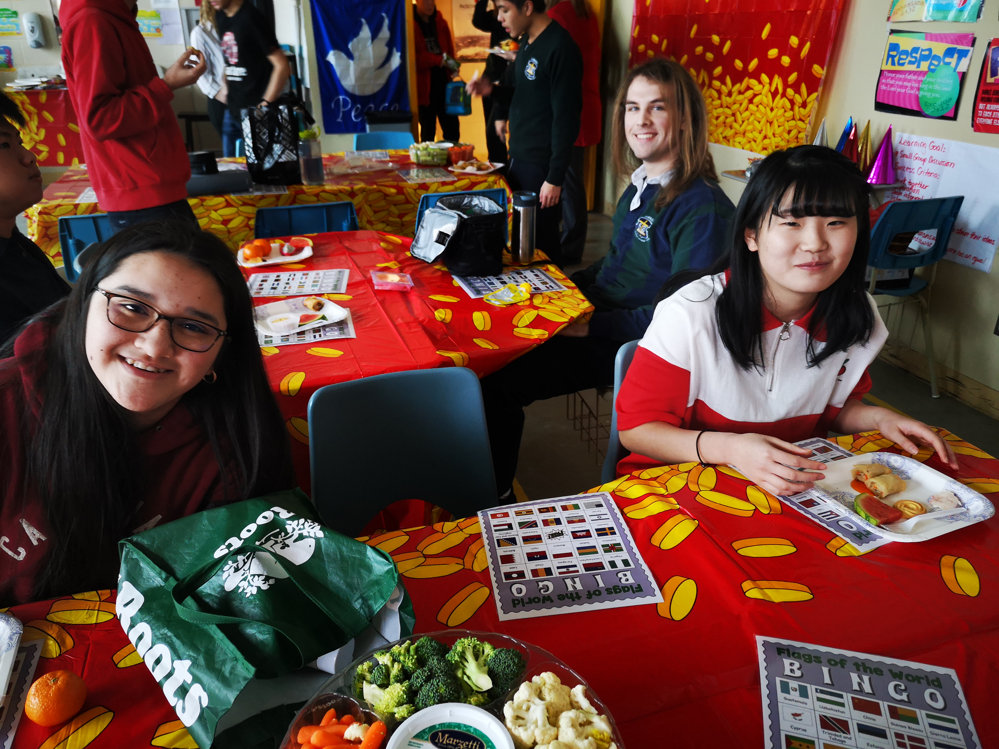 Olivia Daroczi, new student Rina Nagashima and Thomas West get in on the Chinese new year festivities.