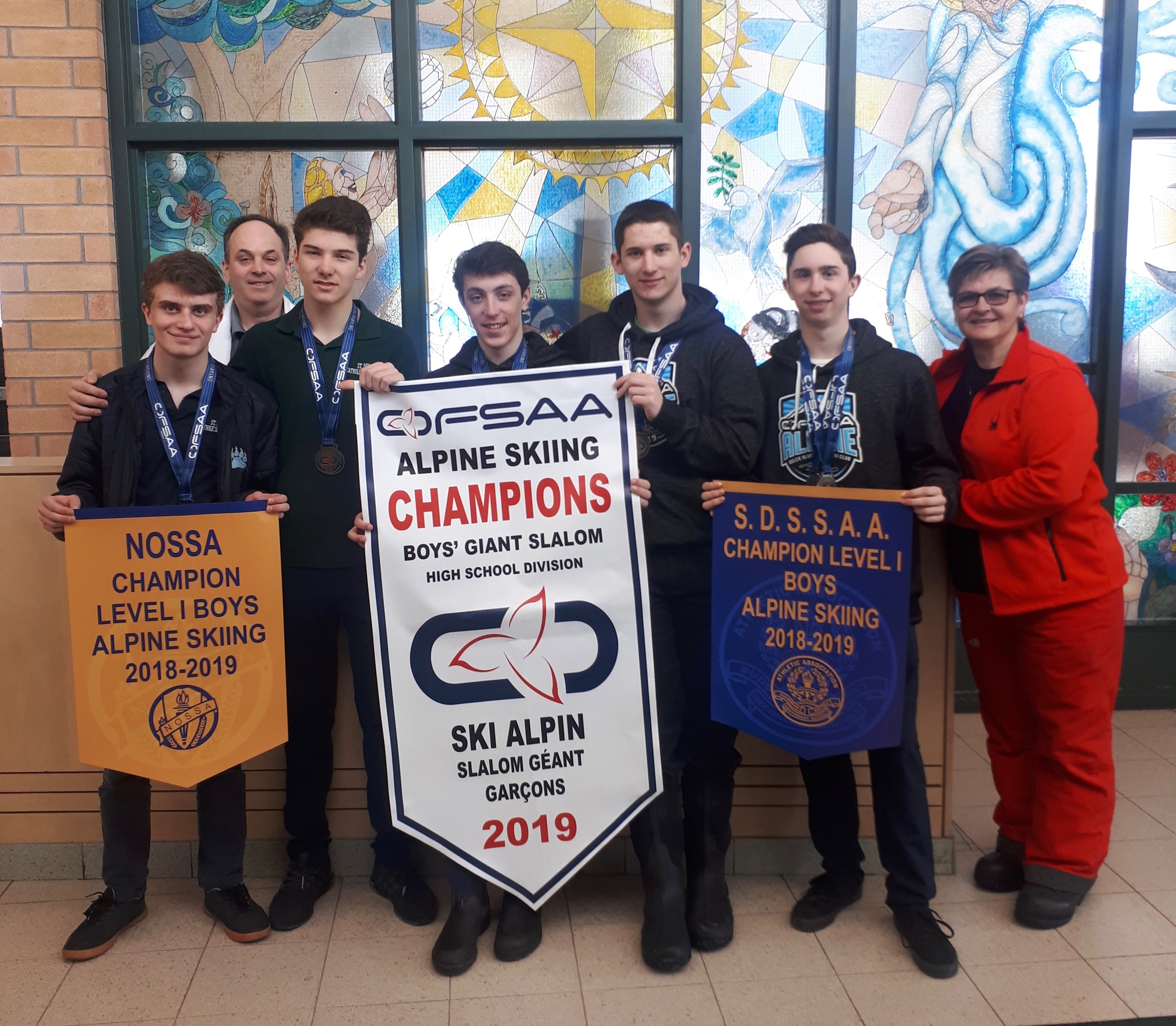 The Alpine Ski team at ST. Benedict stands with their OFSAA Banners.