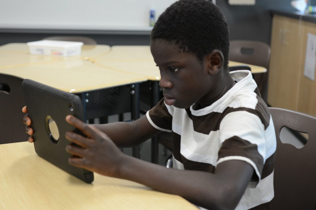 A student completes a reading level on Lexia on his iPad