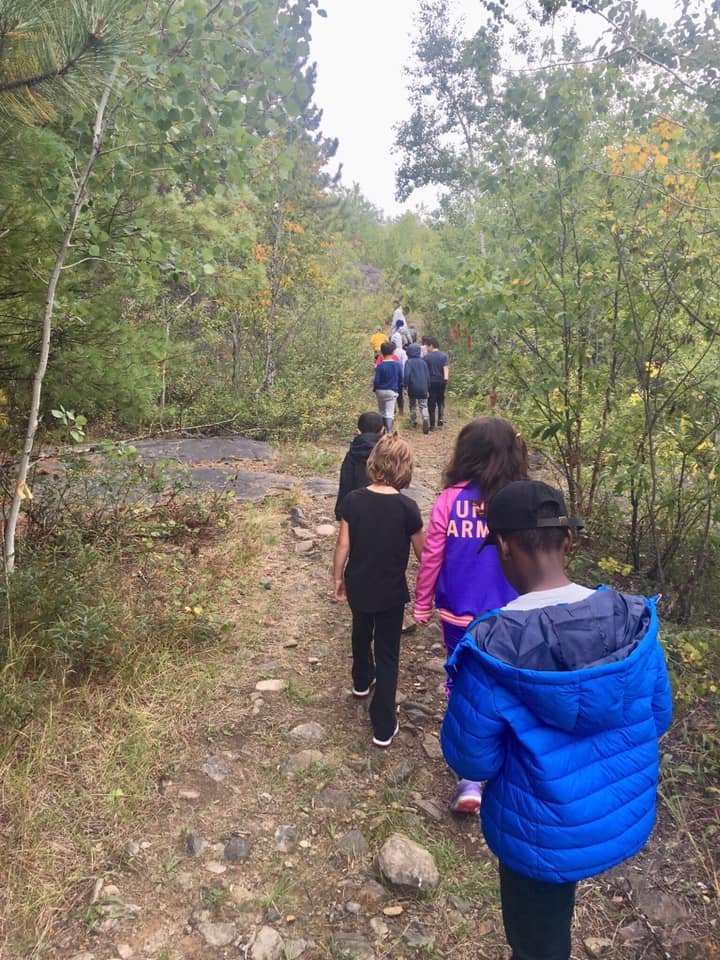 Students walking outdoors.