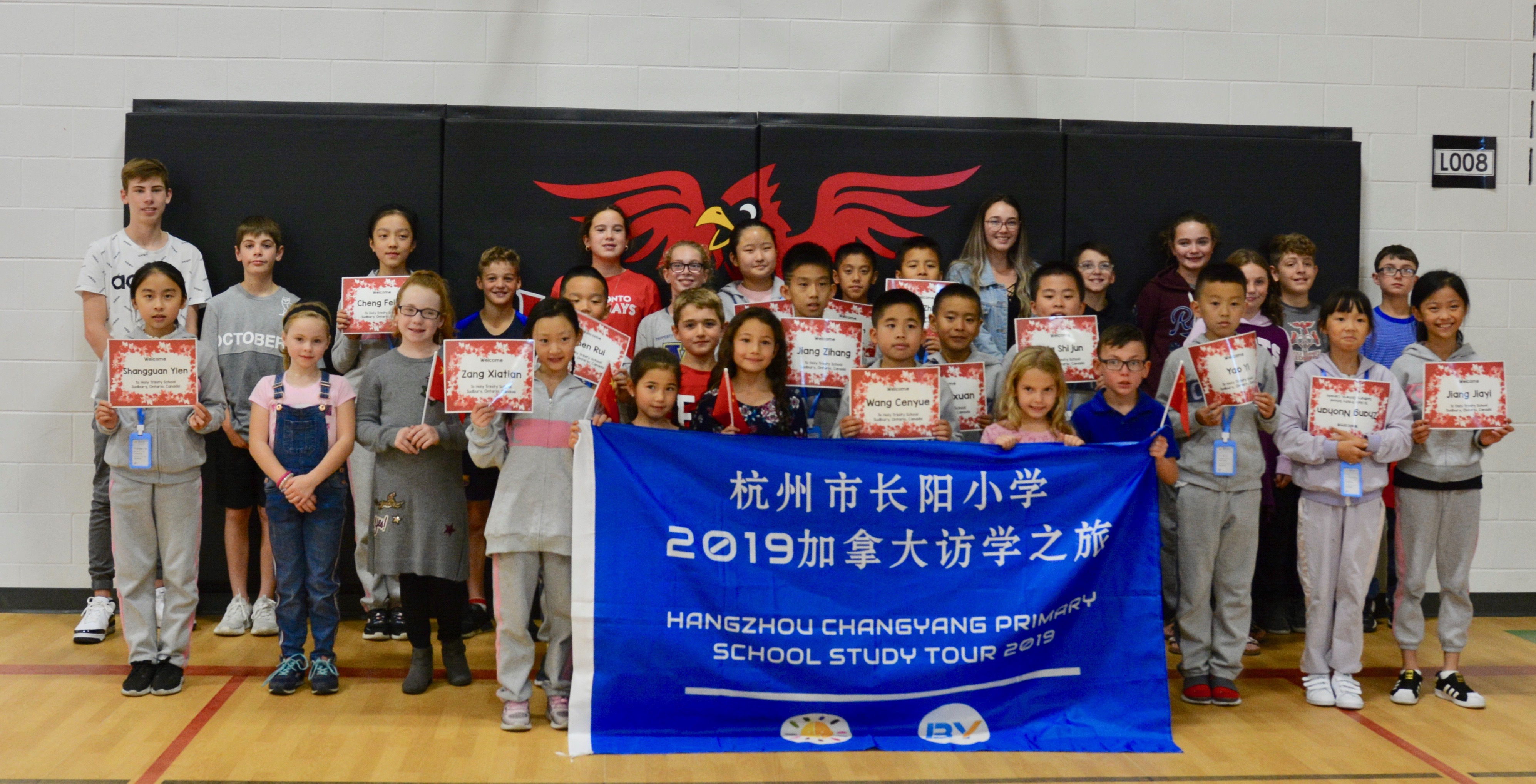Visiting Chinese Students stand with their billet students from Holy Trinity School