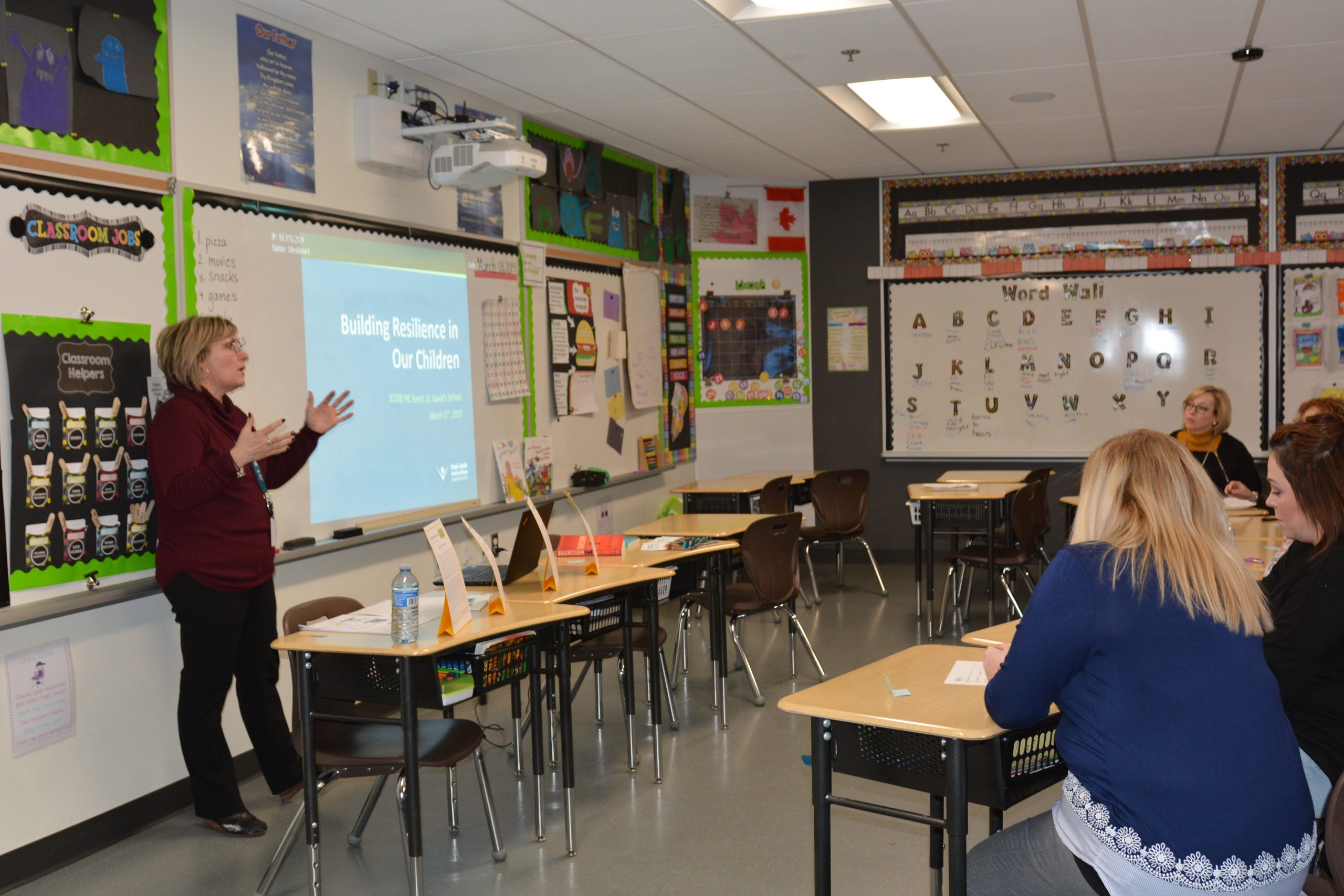 A women talks to a classroom full of parents.