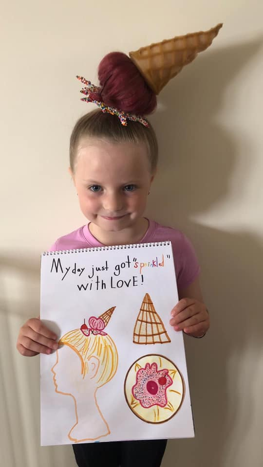 Girl wears ice cream themed hair.