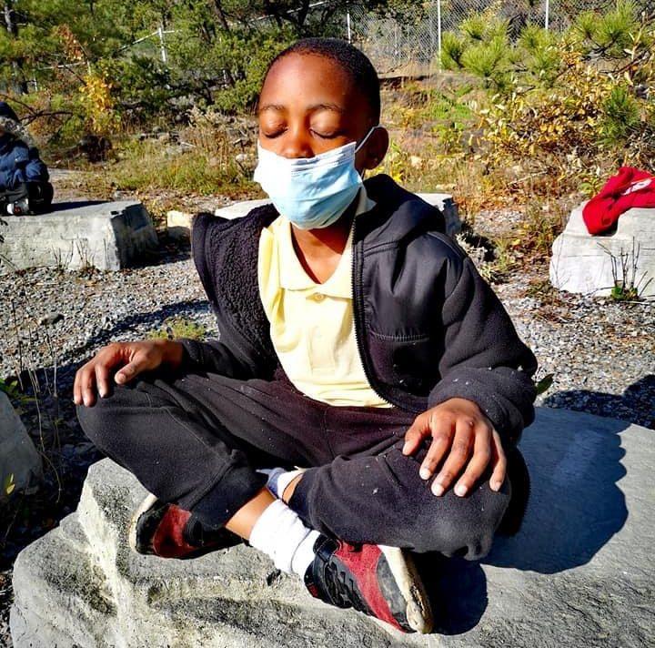 A boy meditates